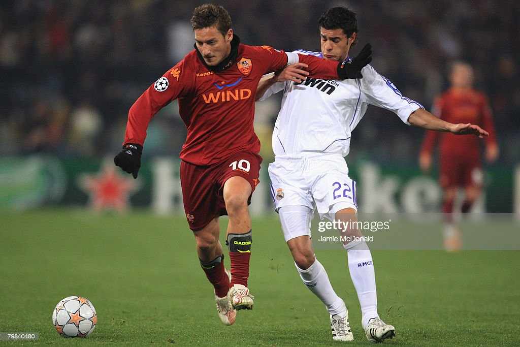 Francesco Totti of Roma battles with Miguel Torres of Madrid during the UEFA Champions League first knockout round, first leg match between AS Roma and Real Madrid at the Olympic Stadium on February 19, 2008 in Rome, Italy.