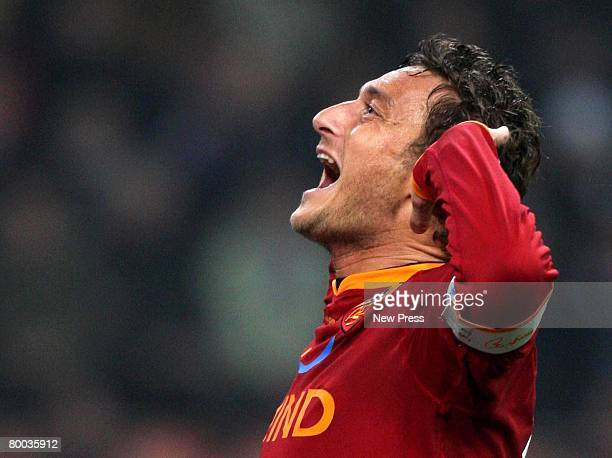 Francesco Totti of Roma celebrates a goal during the Serie A match between Inter and Roma at the Stadio Meazza San Siro on February 27 2008 in Milan...