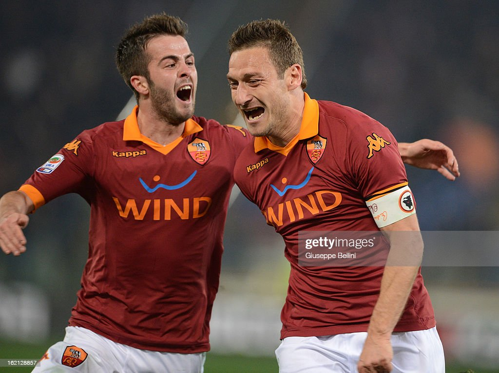 Francesco Totti of Roma celebrates after scoring the opening goal during the Serie A match between AS Roma and Juventus FC at Stadio Olimpico on February 16, 2013 in Rome, Italy.