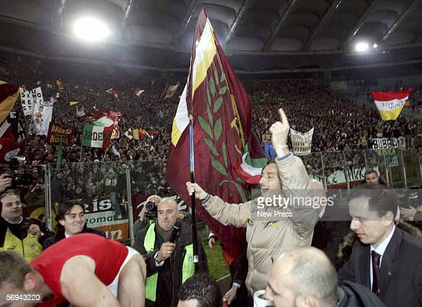 Francesco Totti of Roma celebrates after the Serie A match between Lazio and Roma at the Stadio Olimpico on February 26 2006 in Roma Italy