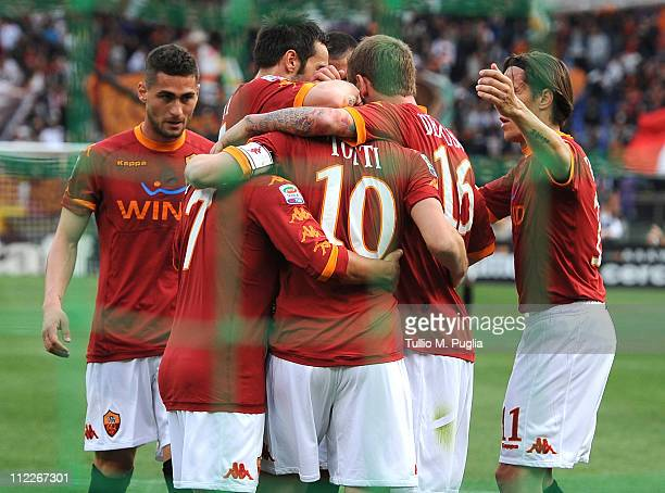 Francesco Totti of Roma celebrates with mates after scoring the opening goal during the Serie A match between AS Roma and US Citta di Palermo at...