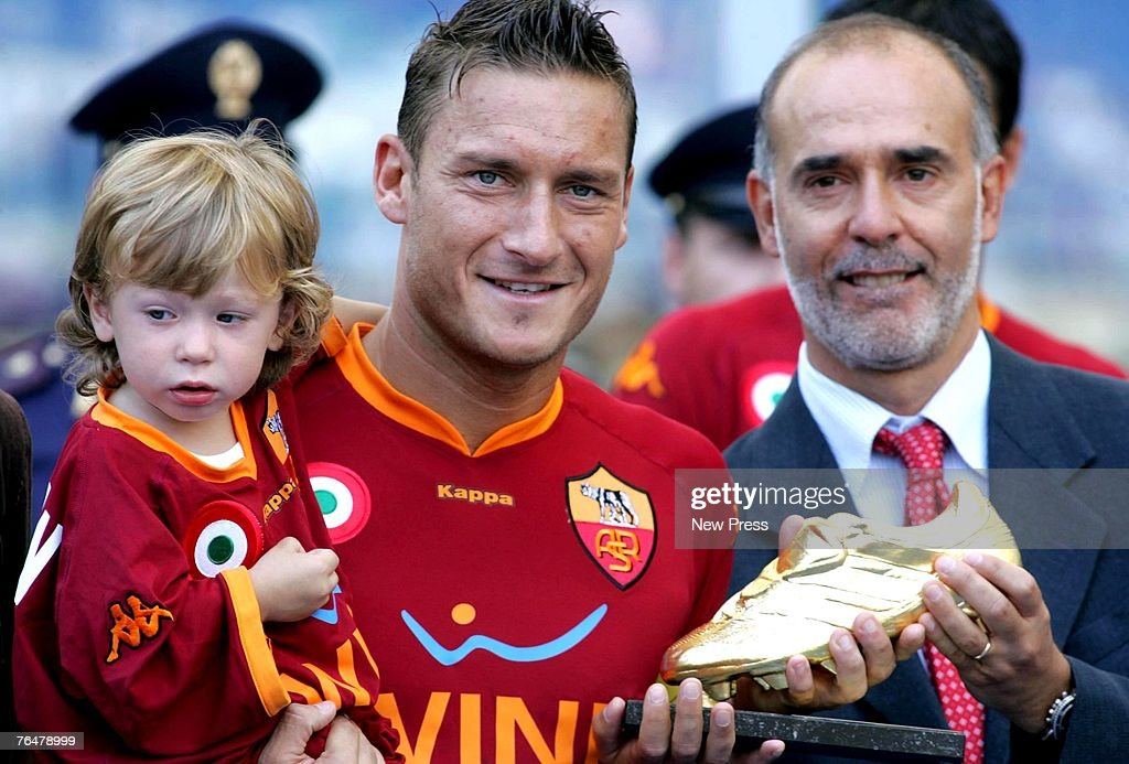 Francesco Totti of Roma holding his son Cristian (L) as he receives the 'Golden Shoe 2007' award as best player of the Italian premier league during a Serie A match between Roma and Siena at the Stadio Olimpico on September 02, 2007 in Rome, Italy.