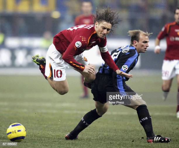 Francesco Totti of Roma is brought down by Esteban Cambiasso of Inter during the Serie A match between Inter Milan and SS Roma played at the...