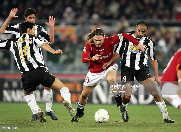 Francesco Totti of Roma is challenged by Ferreira Emerson of Juventus during the Serie A match between AS Roma and Juventus at the Stadio Olimpico on...