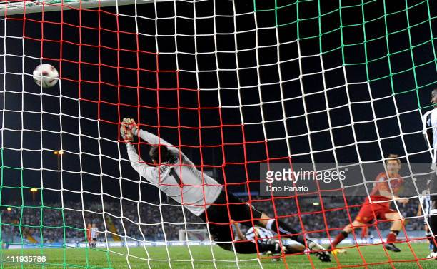 Francesco Totti of Roma scores his second teams goal during the Serie A match between Udinese Calcio and AS Roma at Stadio Friuli on April 9 2011 in...