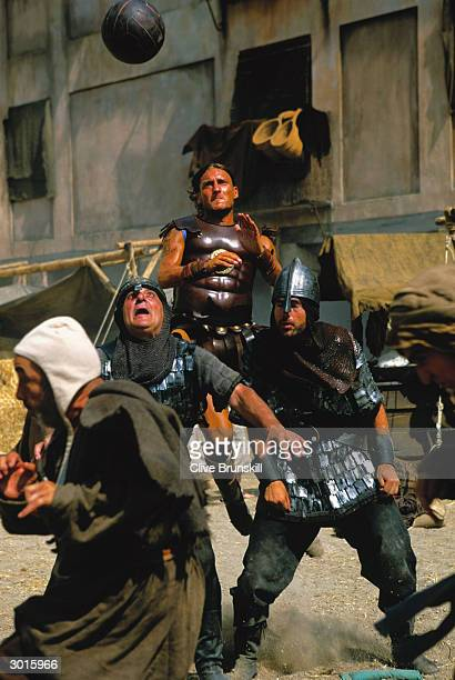 Francesco Totti out-jumps two soldiers to head the ball during the making of the Pepsi football commercial 'Pepsi Foot Battle' held on July 4, 2003...