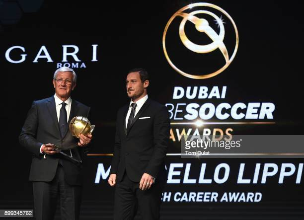 Francesco Totti presents Marcello Lippi with Coach Career Award during the Globe Soccer Awards 2017 on December 28 2017 in Dubai United Arab Emirates