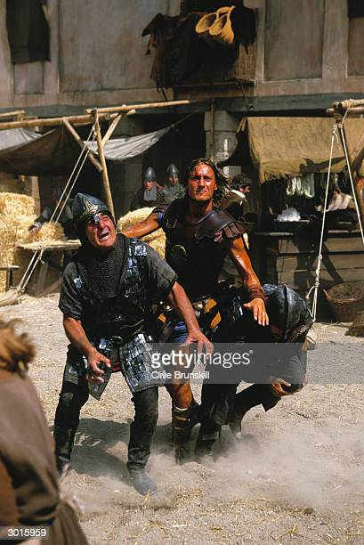 Francesco Totti sends two soldiers crashing to the floor during the making of the Pepsi football commercial 'Pepsi Foot Battle' held on July 4, 2003...