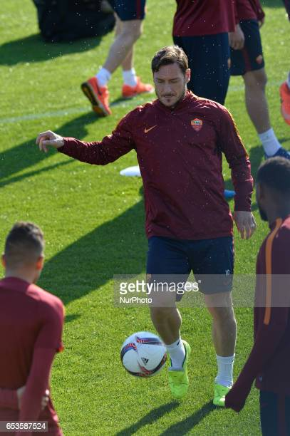 Francesco Totti warms up during a training session on the eve of the team's Europe League football match against Lione at the Trigoria training...