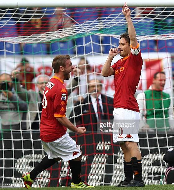 Francesco Totti with his teammate Daniele De Rossi of AS Roma celebrates after scoring the opening goal with a penalty during the Serie A match...