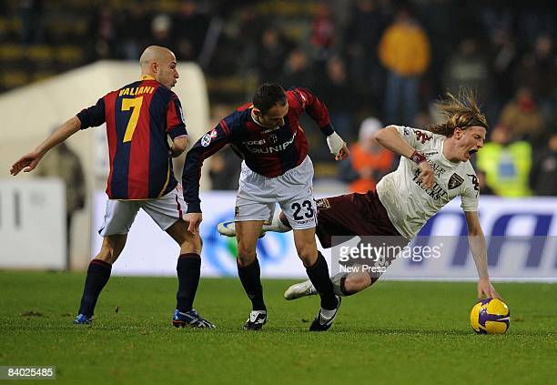 Francesco Valiani and Salvatore Lanna of Bologna competes with Ignazio Abate of Torino during the Serie A match between Bologna and Torino at the...