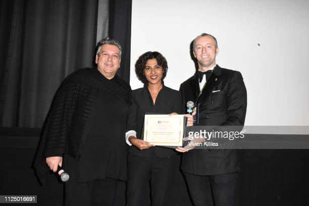 Francesco Vitali and Prince MarioMax SchaumburgLippe present Kankana Chakraborty with the award for best screenplay at the 48 Independent Short Film...