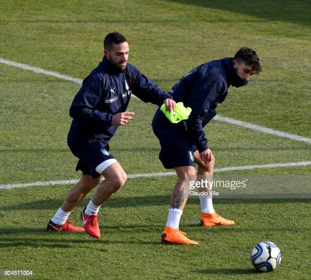 Francesco Zampano and Danilo Cataldi of Italy compete for the ball during a training session at Italy club's training ground at Coverciano at...