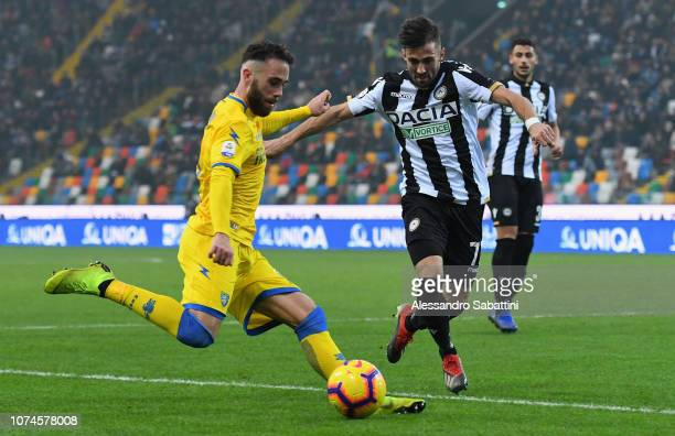 Francesco Zampano of Frosinone Calcio competes for the ball with Marco D'Alessandro of Udinese Calcio during the Serie A match between Udinese and...