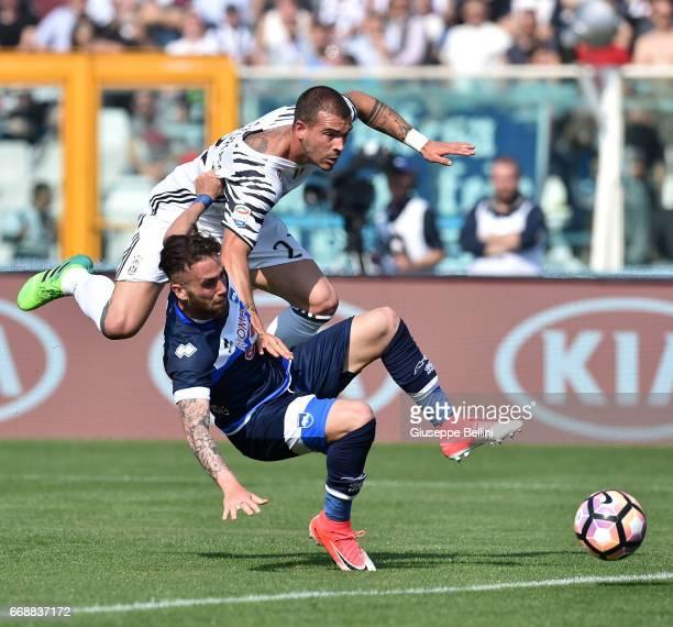 Francesco Zampano of Pescara Calcio and Stefano Sturaro of Juventus FC in action during the Serie A match between Pescara Calcio and Juventus FC at...
