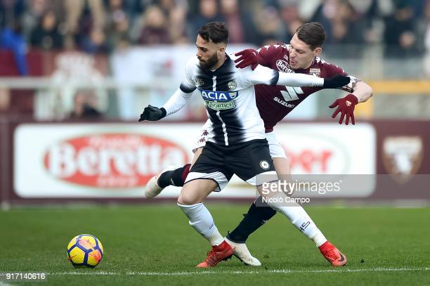 Francesco Zampano of Udinese Calcio competes for the ball with Andrea Belotti of Torino FC during the Serie A football match between Torino FC and...