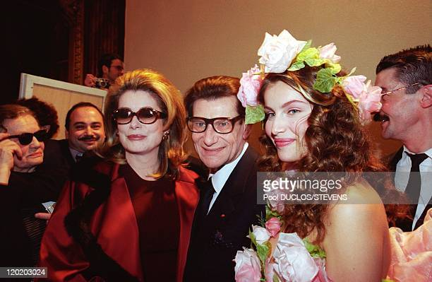 Franch actress Catherine Deneuve French fashion designer Yves Saint Laurent and French model Laetitia Casta pose at Yves Saint Laurent fashion show...
