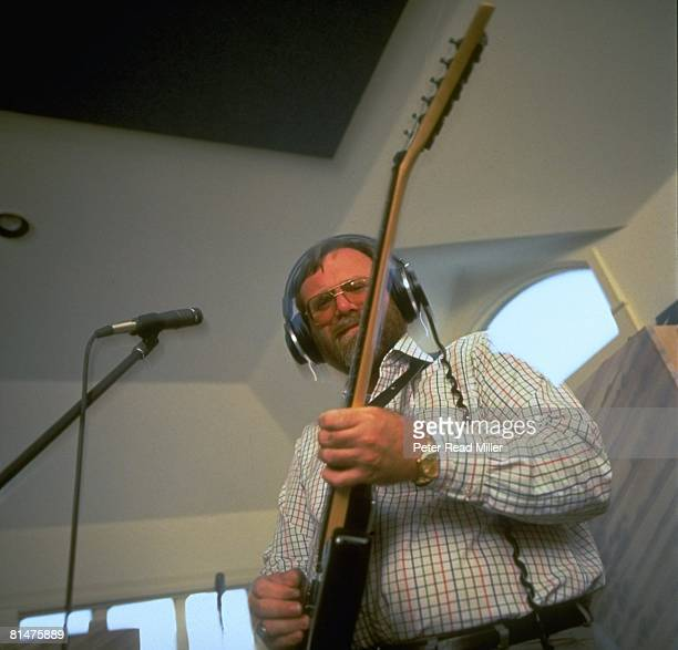Franchise Owners Portrait of Portland Trail Blazers and Seattle Seahawks owner and Microsoft cofounder Paul Allen playing guitar Portland OR 7/21/1993
