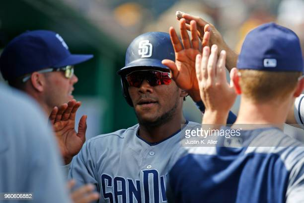 Franchy Cordero of the San Diego Padres celebrates after scoring on a bunt single in the ninth inning against the Pittsburgh Pirates during the game...