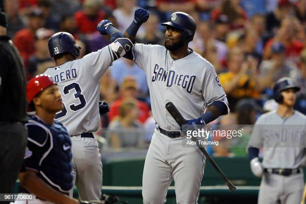 Franchy Cordero of the San Diego Padres celebrates with Franmil Reyes after hitting a solo home run during a game against the Washington Nationals at...