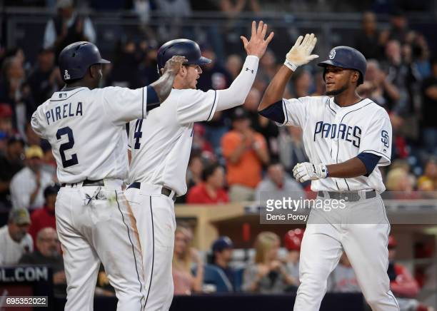 Franchy Cordero of the San Diego Padres right is congratulated by Wil Myers and Jose Pirela after hitting a tworun home run during the second inning...