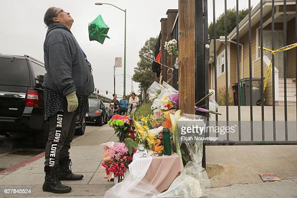 Francia Martinez prays in front of a makeshift memorial near the site of a warehouse fire that has claimed the lives of at least thirtysix people on...