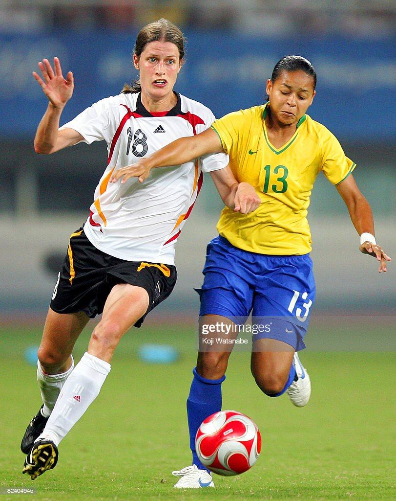 Francielle (R) of Brazil and Kerstin Stegemann of Germany compete for the ball during the Women's Semi Final match between Brazil and Germany at Shanghai Stadium on Day 10 of the Beijing 2008 Olympic Games on August 18, 2008 in Shanghai, China.