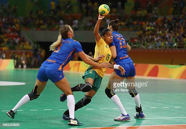 Francielle Rocha of Brazil is challenged by Lois Abbingh of Netherlands and Yvette Broch of Netherlands during he Womens Quarterfinal match between...