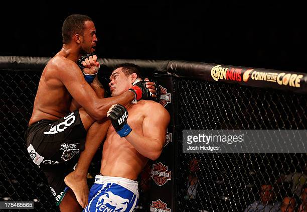 Francimar Barroso and Ednaldo Oliveira trade strikes in their light heavyweight bout during UFC 163 at HSBC Arena on August 3, 2013 in Rio de...