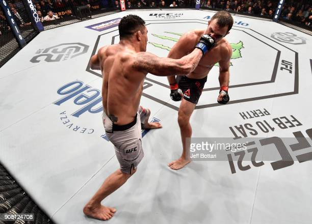 Francimar Barroso of Brazil punches Gian Villante in their light heavyweight bout during the UFC 220 event at TD Garden on January 20 2018 in Boston...