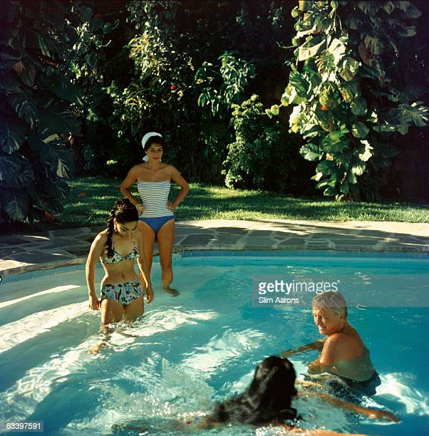 Francine Brandt and Teddy Stauffer take a dip in Acapulco Mexico 1961