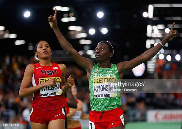 Francine Niyonsaba of Burundi crosses the line to win gold ahead of Ajee Wilson of the United States in the Women's 800 Metres Final during day four...