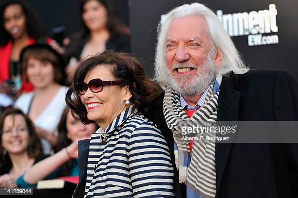 Francine Racette and actor Donald Sutherland arrive to the premiere of Lionsgate's The Hunger Games at Nokia Theatre LA Live on March 12 2012 in Los...