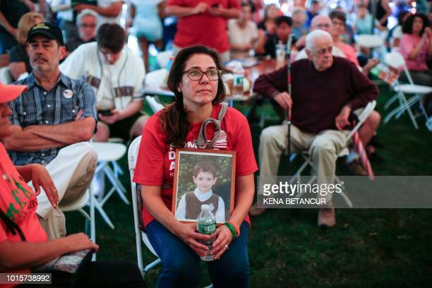 TOPSHOT Francine Wheeler displays a photograph of her son Sandy Hook Elementary shooting victim Ben Wheeler at March for our Lives Rally at Fairfield...