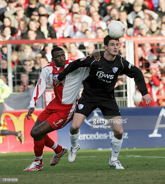 Francis Adissa Kioyo of Cottbus battles for the ball with Marcel Maltritz of Bochum during the Bundesliga match between Energie Cottbus and VFL...