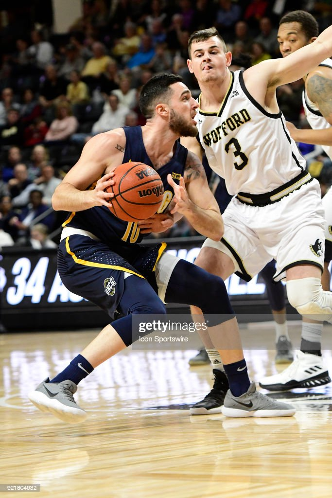 Francis Alonso (ESP)(10) guard University of North Carolina Greensboro (UNCG) Spartans looks for a path around Fletcher Magee (3) guard Wofford College Terriers, Tuesday, February 20, 2018, at Richardson Indoor Stadium in Spartanburg, South Carolina. UNC Greensboro wins 76-66.