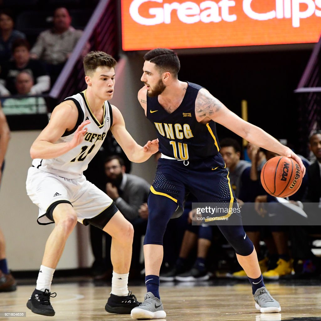 Francis Alonso (ESP)(10) guard University of North Carolina Greensboro (UNCG) Spartans keeps the basketball away from Nathan Hoover (10) guard Wofford College Terriers, Tuesday, February 20, 2018, at Richardson Indoor Stadium in Spartanburg, South Carolina. UNC Greensboro wins 76-66.