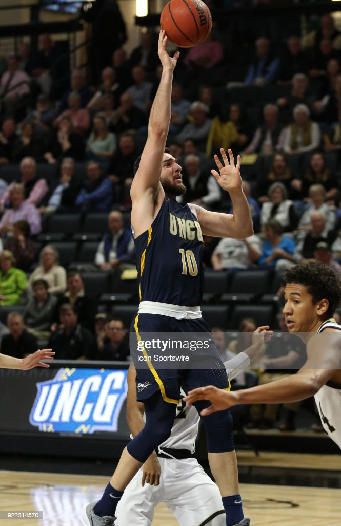Francis Alonso (10) UNC Greensboro passes the ball during action against Wofford at Jerry Richard indoor stadium in Spartanburg,SC on Tuesday February 20, 2018.