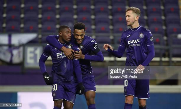 Francis Amuzu of Anderlecht celebrates with Hannes Delcroix of Anderlecht and Michel Vlap of Anderlecht after scoring the 3-0 goal during the Jupiler...