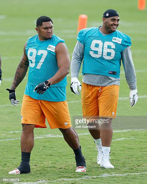 J Francis and Isaako Aaitui of the Miami Dolphins participate in drills during the teams first OTA on May 27 2014 at the Miami Dolphins training...
