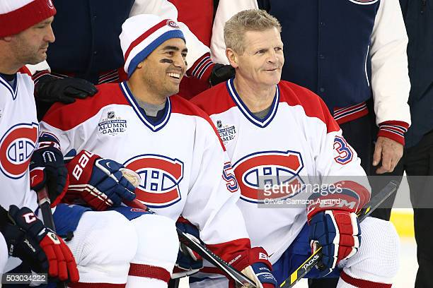 Francis Bouillon and Chris Nilan of the Montreal Canadiens pose for a tea photo before the game against the Boston Bruins in the Alumni Game on...