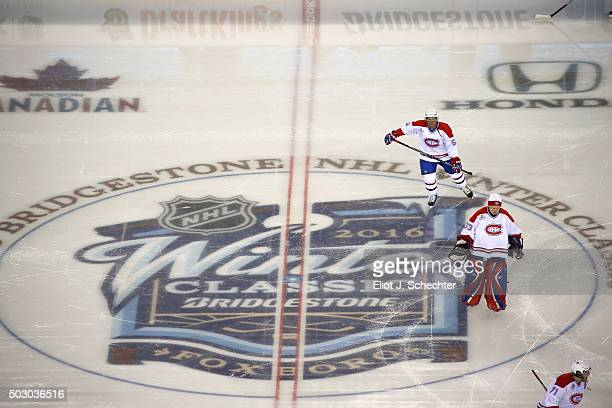 Francis Bouillon and Richard Sevigny of the Montreal Canadiens Alumni Team take the ice for the Alumni Game as part of the 2016 Bridgestone NHL...