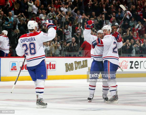 Francis Bouillon of the Montreal Canadiens celebrates his game winning goal against the Florida Panthers with teammates Kyle Chipchura and Josh...