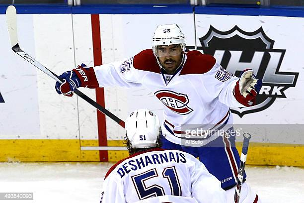 Francis Bouillon of the Montreal Canadiens celebrates with his teammate David Desharnais after scoring a goal in the second period against Henrik...
