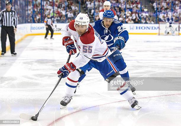 Francis Bouillon of the Montreal Canadiens controls the puck against JT Brown of the Tampa Bay Lightning during the third period in Game Two of the...