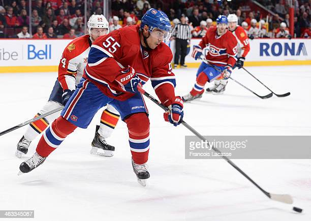 Francis Bouillon of the Montreal Canadiens controls the puck followed by Brad Boyes of the Florida Panthers during the NHL game on January 6 2014 at...