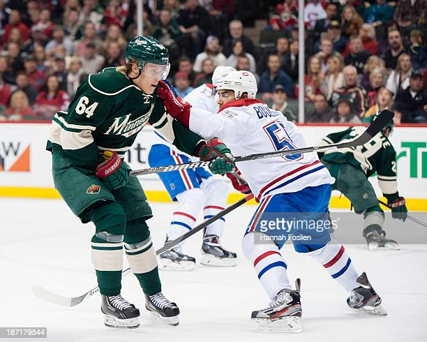 Francis Bouillon of the Montreal Canadiens defends against Mikael Granlund of the Minnesota Wild during the game on November 1 2013 at Xcel Energy...