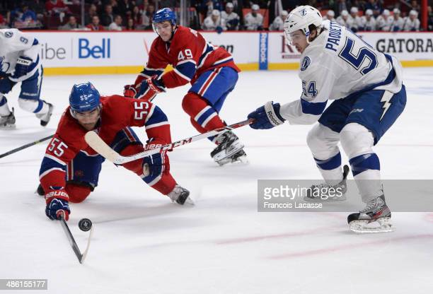 Francis Bouillon of the Montreal Canadiens fights for the puck against Cedric Paquette of the Tampa Bay Lightning in Game Four of the First Round of...