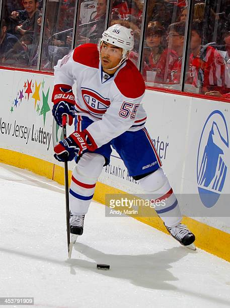 Francis Bouillon of the Montreal Canadiens plays the puck against the New Jersey Devils during the game at the Prudential Center on December 4 2013...