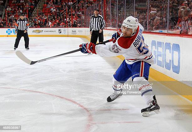 Francis Bouillon of the Montreal Canadiens shoots the puck during their NHL game against the Carolina Hurricanes at PNC Arena on February 8 2014 in...